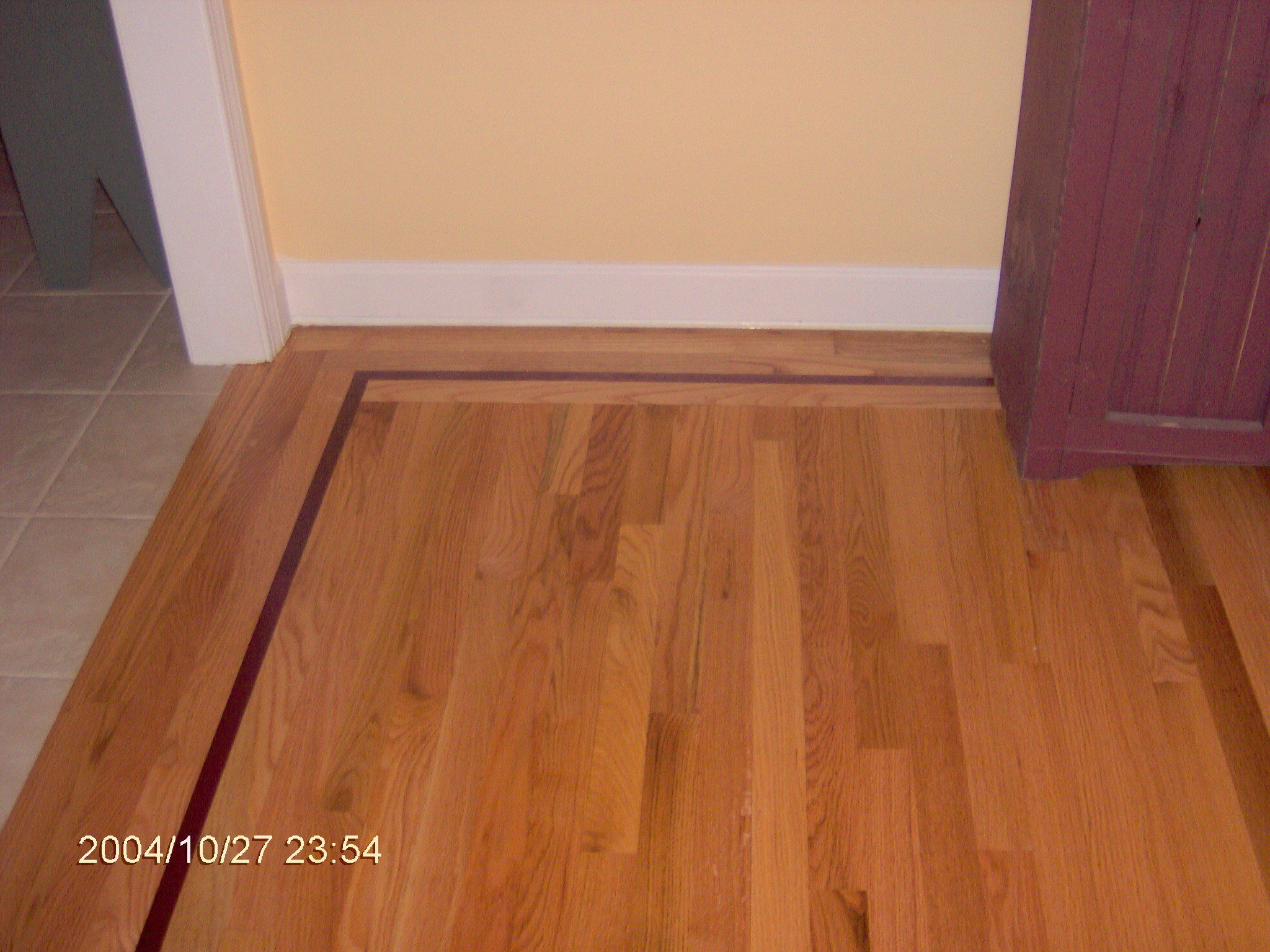 How s about a nice in lay walnut or purple heart baker for Purple heart flooring